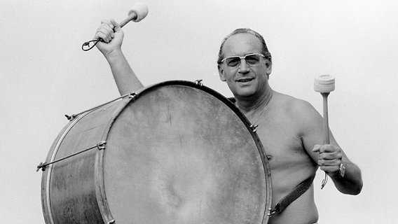 Max bangs his own drum