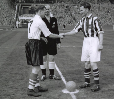 Tom shakes hands with the West Brom captain, Len Millard, at start of 1954 FA Cup Final