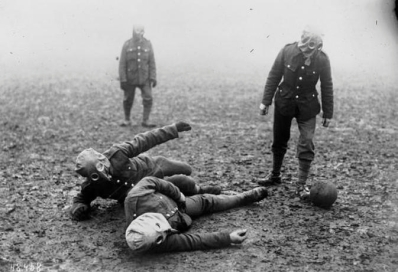 British soldiers play football wearing gas masks, 1915
