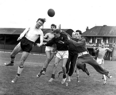 Third Lanark's George MCCallum wins a header during training, 1960