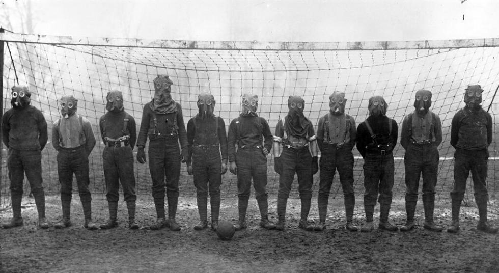 British football team wearing gas masks, northern France, 1916