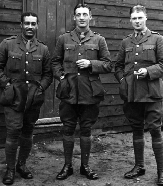 Ex-Tottenham player Walter Tull (left) with fellow officers in 1917. He served as an officer in Italy and France & was killed in action