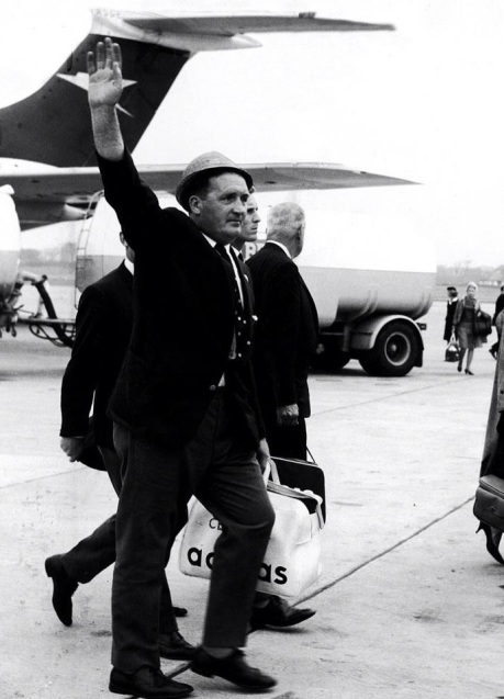 Jock Stein acknowledges the crowds at Glasgow Airport awaiting the party's return