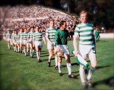 Celtic players walk out on to the pitch before kick-off
