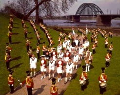 NEC Nijmegen players with a local marching band