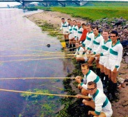 PEC Zwolle players fish on the River Ijssel, 1963