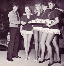 George Best measures girls for collecting toys for Xmas charities