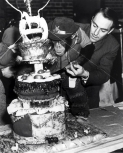 Jimmy Greaves & Linda the chimp cutting the Christmas cake
