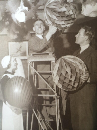 Liverpool players Tom Bradshaw & Alf Hobson put up decorations at a Rhyl hotel, 1936