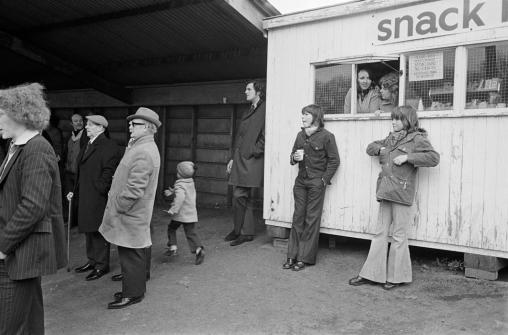 Halifax Town FC. Spectators and catering, 1975 (Martin Parr)