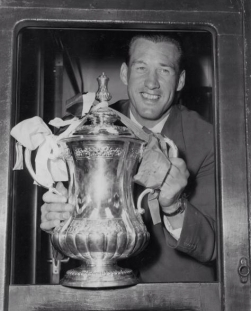 Bolton Wanderers' Nat Lofthouse shows off the FA Cup after defeating Manchester United in the 1958 final