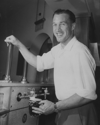 Nat Lofthouse pulling a pint July 1957