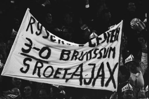 Ajax fans fly a banner predicting (correctly) that their team will win 3-0