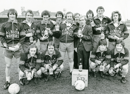 Albion Rovers team photographed with crate of J&B whisky. Taken prior to cup-tie with Morton. Ray Franchetti was presented with a case of J&B whisky, his reward for scoring a hat-trick against Stranraer 1978