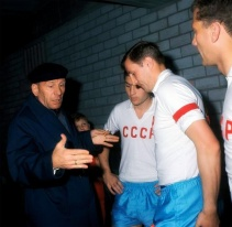 Coach Morozov instructs his players before the Soviet Union World Cup game with North Korea, 1966